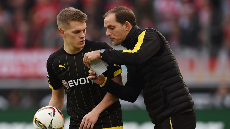 Matthias Ginter speaks with former Borussia Dortmund manager Thomas Tuchel