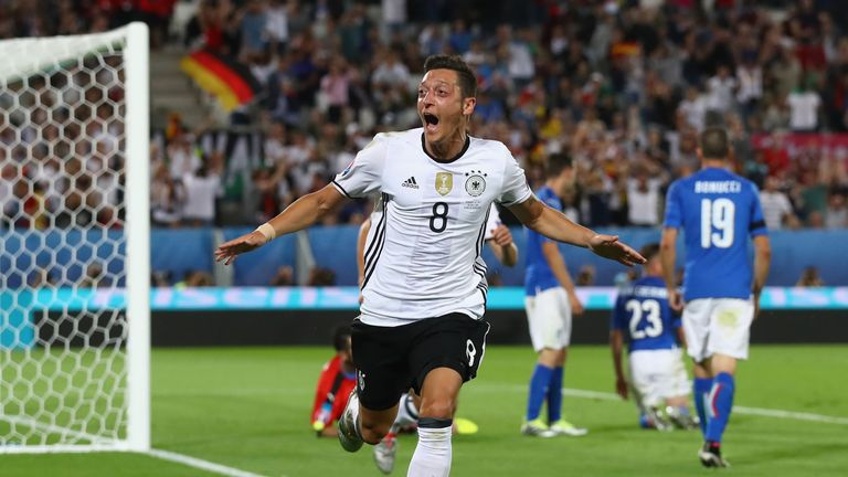 Mesut Ozil celebrates scoring the opening goal against Italy