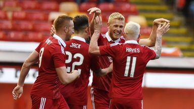 Jayden Stockley (2nd right) celebrates his goal against Ventspils at Pittodrie