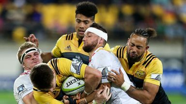 WELLINGTON, NEW ZEALAND - APRIL 23:  Beauden Barrett of the Hurricanes is tackled by Sam Cane and Aaron Cruden of the Chiefs during the round nine Super Ru