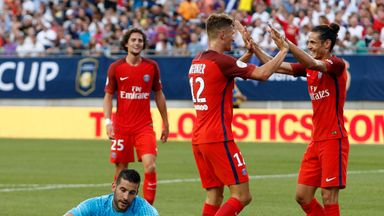 Paris Saint-Germain defender Thomas Meunier (C) celebrates his second goal