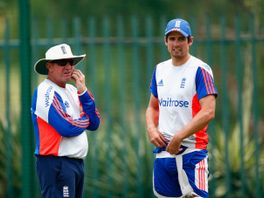 England coach Trevor Bayliss (left) and Alastair Cook talk during training