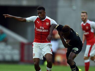 Nigerian forward Alex Iwobi (left) vies with Lens forward Deme Ndiaye