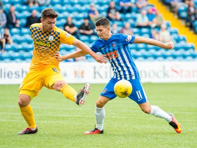 Ross Forbes and Jordan Jones compete for the ball