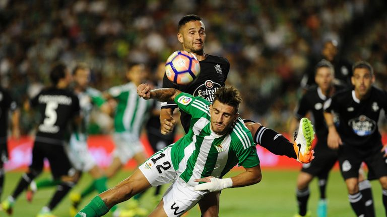 Betis' Cristiano Piccini is tackled by Andone