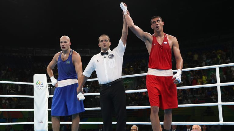 Evgeny Tishchenko celebrates his controversial gold