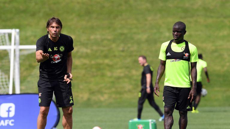 N'Golo Kante (R) training alongside Chelsea boss Antonio Conte