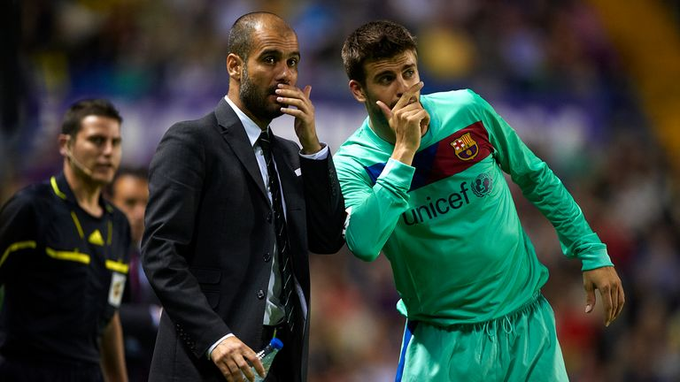 Pep Guardiola gives instructions to Gerard Pique when in charge of Barcelona