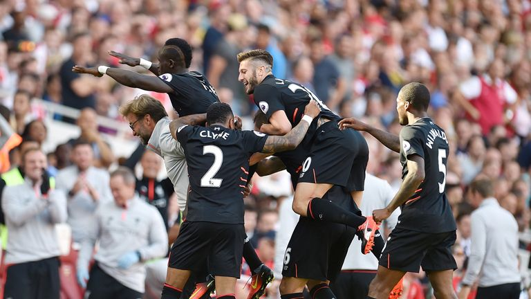 Sadio Mane celebrates with manager Jurgen Klopp after scoring Liverpool's fourth goal