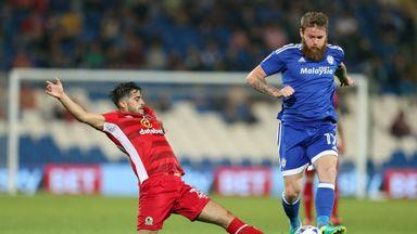 Cardiff City's Aron Gunnarsson battles for the ball.