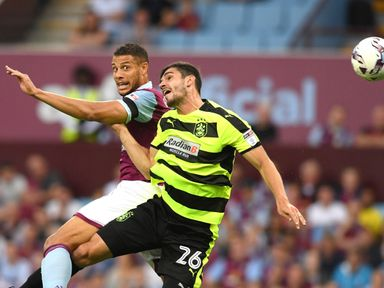Christopher Schindler (r) earned Huddersfield all three points