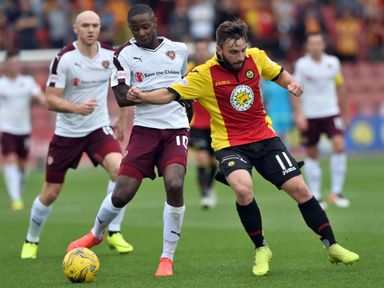 Arnaud Djoum (left) and Partick's Steven Lawless in action