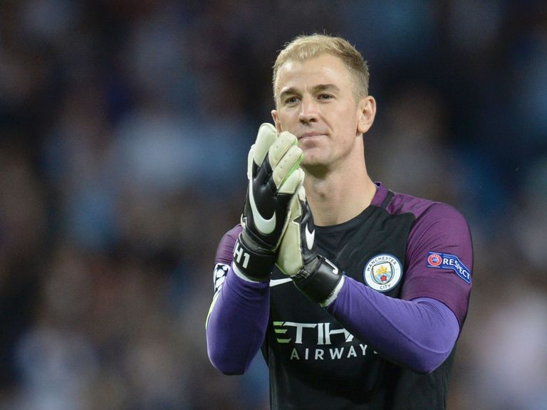 Manchester City's English goalkeeper Joe Hart gestures to the crowd at the end of the UEFA Champions league second leg play-off football match between Manc