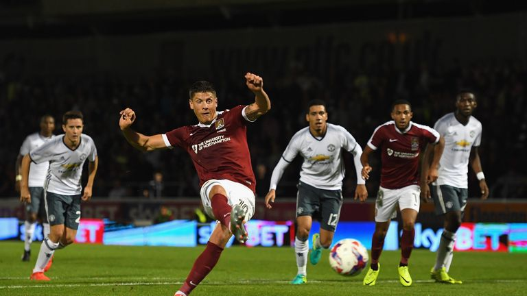 Alex Revell of Northampton Town scores his side's first goal