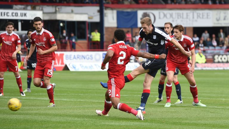 Dundee left-back Kevin Holt scores his first of three goals so far this season against Aberdeen in September