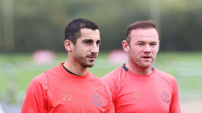 Mkhitaryan and Wayne Rooney in training