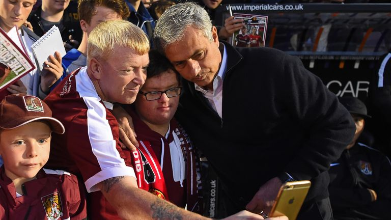 Manchester United manager Jose Mourinho pictured with the Northampton Town fans before kick-off