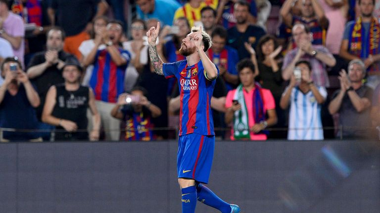 Lionel Messi celebrates scoring the first of his three goals as Barcelona thrashed Celtic at the Nou Camp
