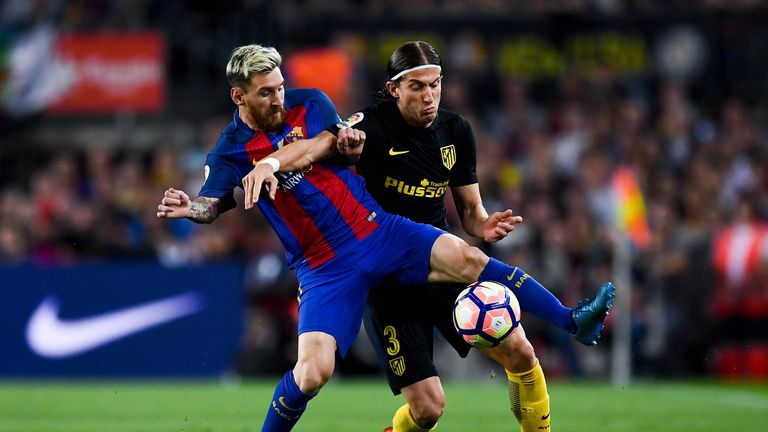 Messi battles with Filipe Luis at the Nou Camp