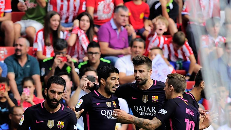 Luis Suarez is congratulated after scoring the opener for Barcelona