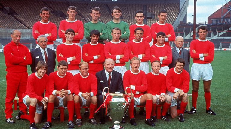 The Manchester United squad line up with manager Matt Busby and the European Cup in July 1968