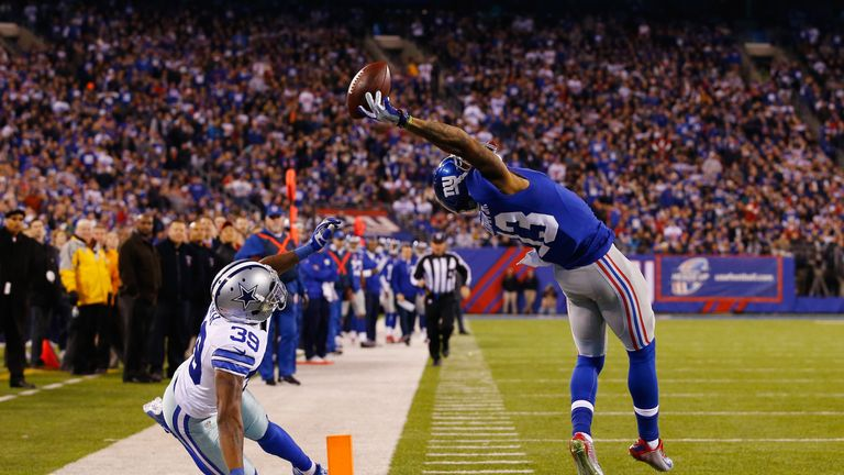 Catching his phone helped Odell Beckham Jr to pull off one-handed catches like this one against the Dallas Cowboys