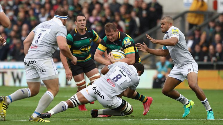 Dylan Hartley is tackled by Bath No 8 Taulupe Faletau
