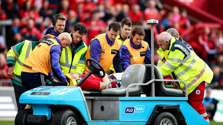 Jack O'Donoghue is stretchered off following a collision with Fraser McKenzie
