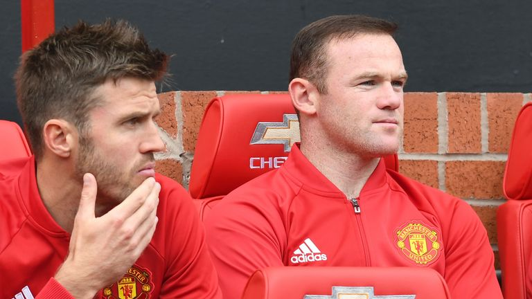 Carrick (L) has spent plenty of time on the bench alongside skipper Wayne Rooney this season