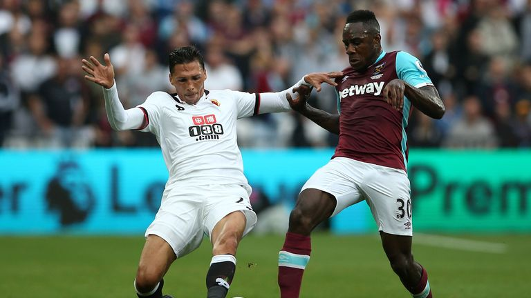 Watford's José Holebas (left) vies with West Ham winger Michail Antonio