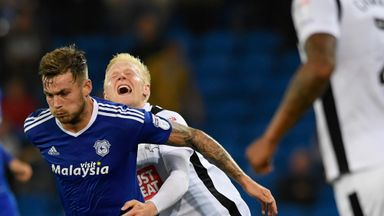 Derby's Will Hughes (r) attempts to challenge Joe Ralls of Cardiff