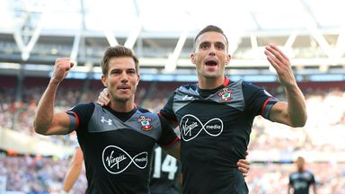 Dusan Tadic (R) celebrates scoring for Southampton against West Ham