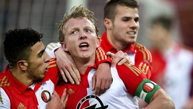 Feyenoords' Dirk Kuyt (C) is congratulated by team-mates after scoring the late equaliser against Ajax