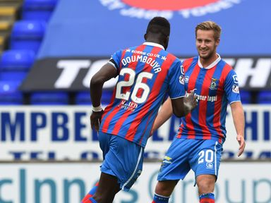 Inverness's Lonsana Doumbouya (left) celebrates his goal with Billy King