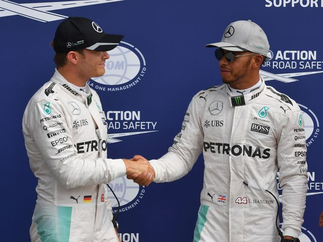 Nico Rosberg (l) beat team-mate Lewis Hamilton at Monza