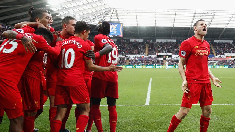 James Milner celebrates his winner for Liverpool