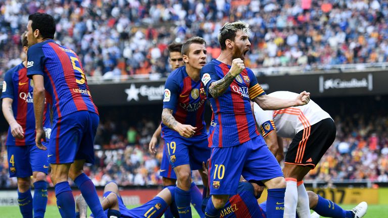 Lionel Messi celebrates after scoring from the spot