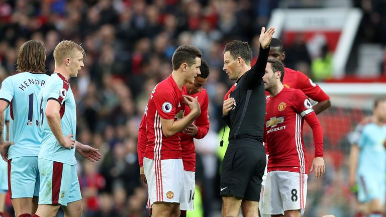 Manchester United's Ander Herrera protests to Clattenburg after a red card