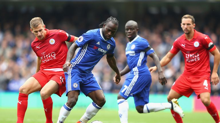 Marc Albrighton of Leicester (left) puts pressure on Chelsea's Victor Moses