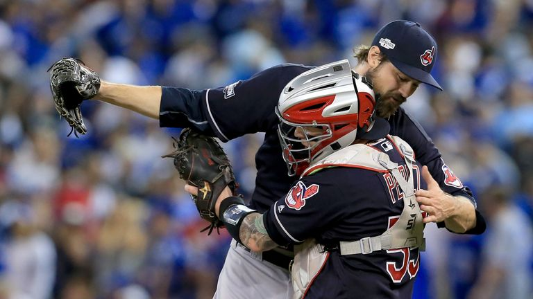 Andrew Miller #24 and team-mate Robert Perez #55 embrace after historic win over Toronto Blue Jays