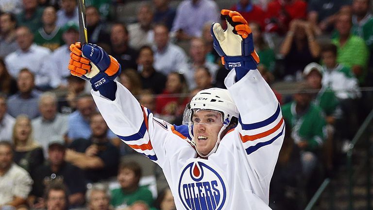 Connor McDavid #97 of the Edmonton Oilers celebrates his first career NHL goal against the Dallas Stars