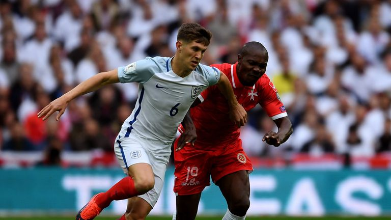 John Stones holds off pressure from Alfred Effiong