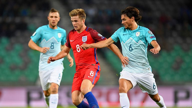 Eric Dier of England battles for the ball with Rene Krhin of Slovenia