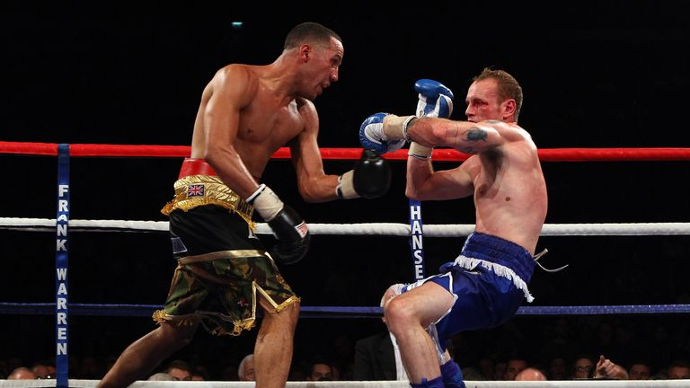James DeGale (L) pushes George Groves back in the British and Commonwealth Super-Middleweight Championship