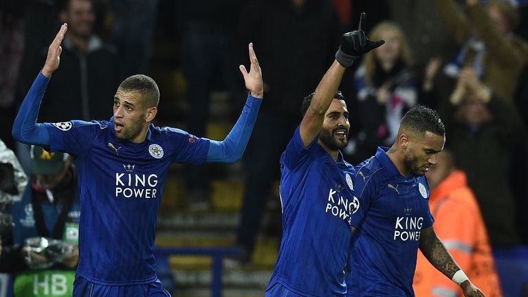 Islam Slimani (left) celebrates with Leicester goalscorer Riyad Mahrez at the King Power