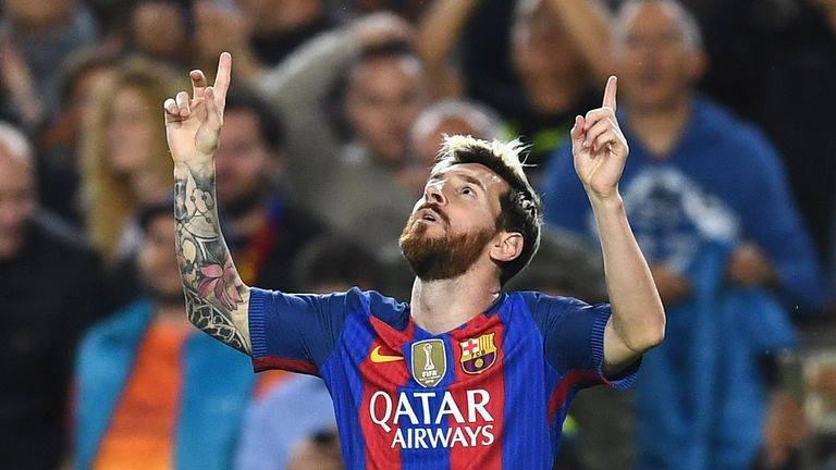 Messi celebrates scoring the opening goal