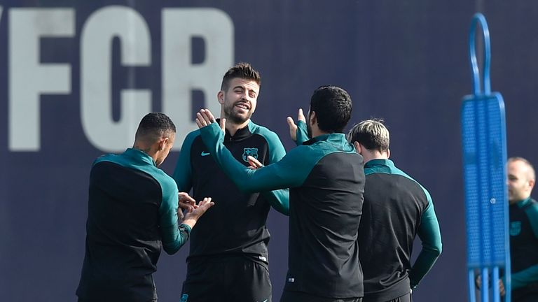 The dust appears to settle as Pique smiles