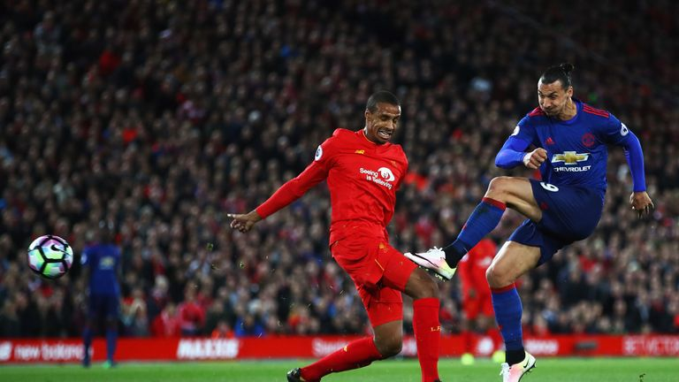 LIVERPOOL, ENGLAND - OCTOBER 17: Joel Matip of Liverpool closes down Zlatan Ibrahimovic of Manchester United as he shoots during the Premier League match
