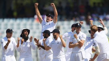 England's captain Alastair Cook (top 3rd L) celebrates with team-mates after beating Bangladesh