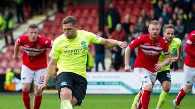 Hibernian's Grant Holt scores from the spot against Dunfermline
